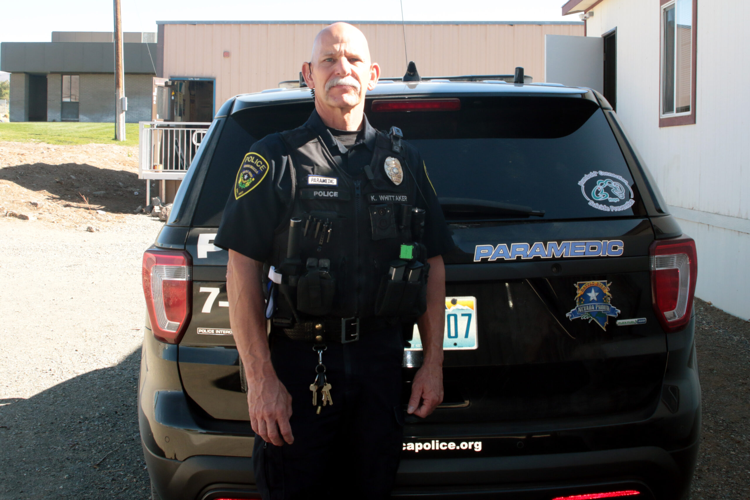 Officer Whittaker poses by his patrol vehicle./Araceli Galarza • Lowry Multimedia Communications