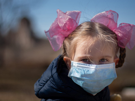 Small girl wearing a mask./ Courtesy • healthpolicy-watch.news