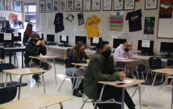 Students wearing a mask in the classroom./ Ron Espinola • Lowry Multimedia Communication