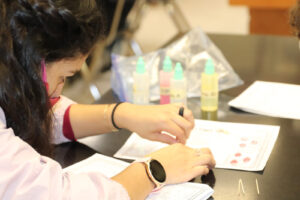 A student learns to find different blood types./ Hadley Hatch • Lowry Multimedia Communication
