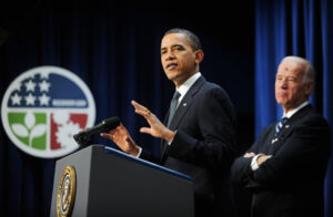 President Barack Obama speaks while Vice President Joe Biden stands in the background. /Olivier Douliery/Abaca Press/MCT