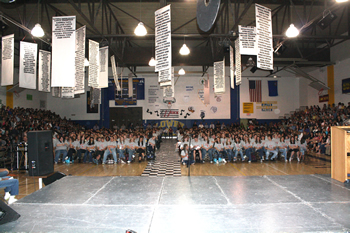 Students fill the New Gym for the Assembly of Excellence. /Ron Espinola • The Brand