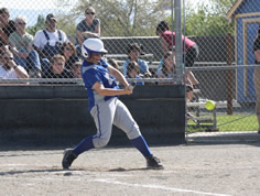 Dana Pardovich swings at a pitch during the Zone Tournament./Ron Espinola • THE BRAND