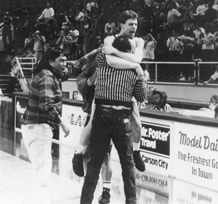 Chad Peters jumps into Mendiola's arms upon winning the state basketball title in 1992./Courtesy • JOYCE MENDIOLA
