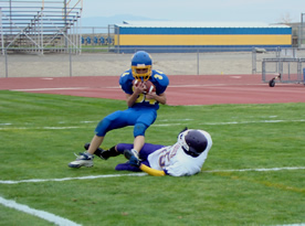 Runningback Bret Hammon catches a touchdown pass in Lowry's 41-28 loss to Lassen September 5, 2008./Jayna Hill • The Brand