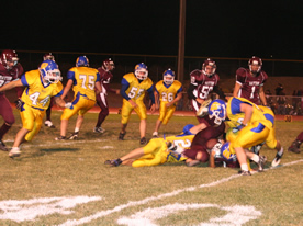 Lowry players tackle a Dust Devil runningback in the Bucks' 12-6 win on October 24, 2008./Stephanie Cochrane • The Brand
