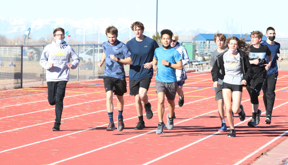 The Cross Country team running warmup laps. /Ron Espinola • The Brand