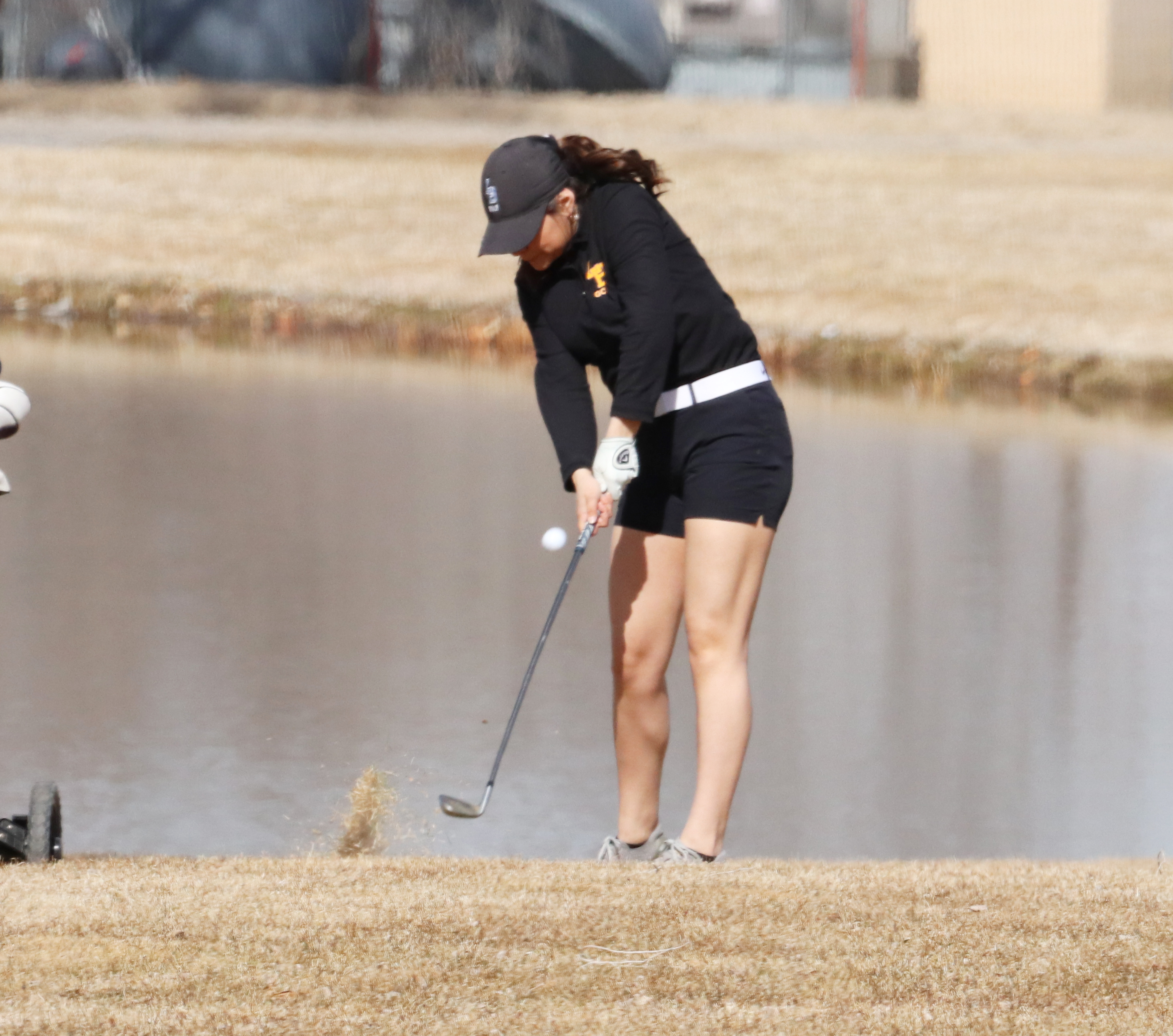 Angelina Martinez recovers after her ball landed near a water hazard. /Ron Espinola • The Brand