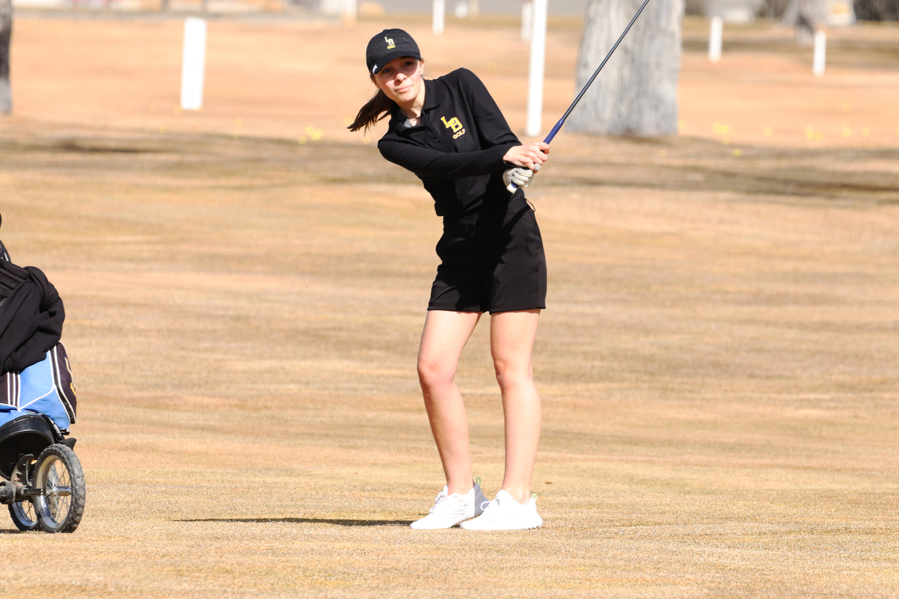Kaitlyn Hales hits an approach shot from the fairway. /Ron Espinola • The Brand