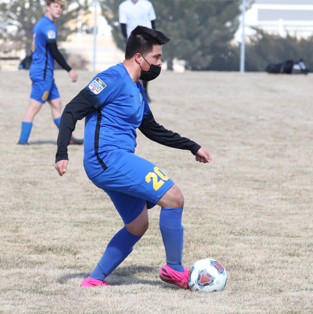 Luis Solis dribbles up field. /Ron Espinola • The Brand