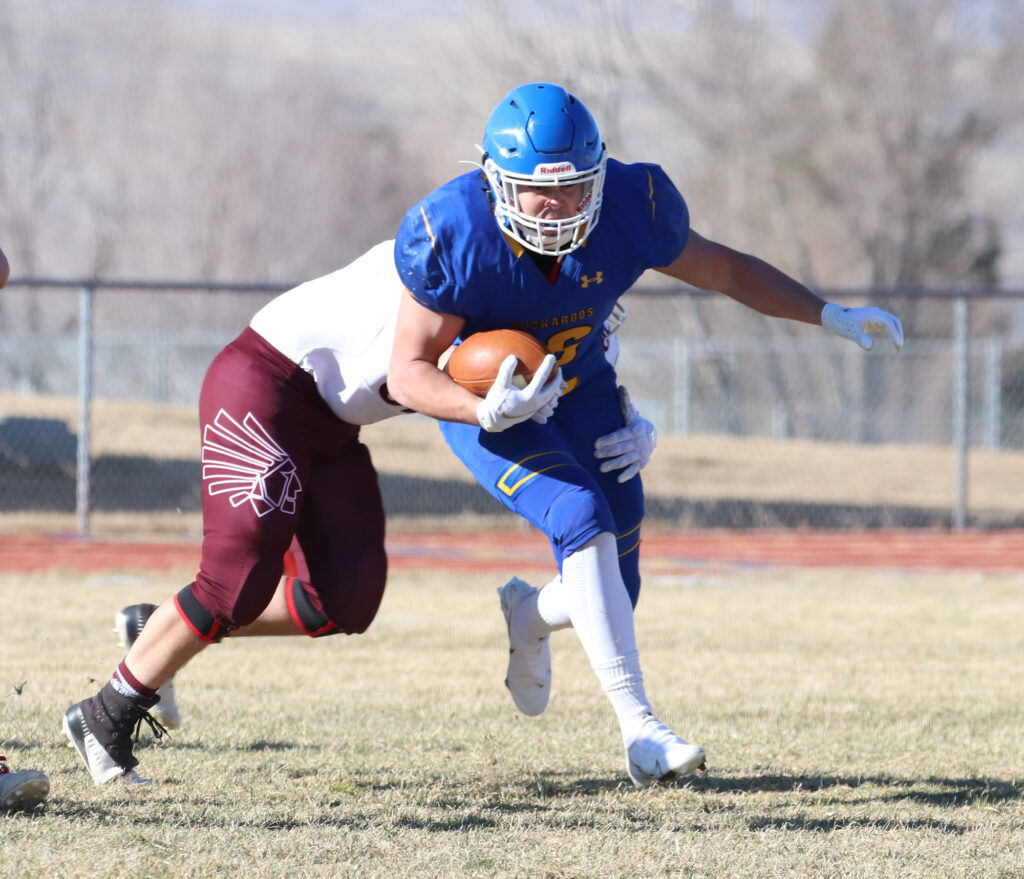 Anthony Peterson tries to get away from an Elko tackler. /Ron Espinola • The Brand