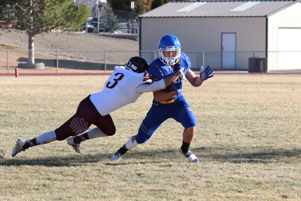 Giovanni Sapien breaks the first of several tackles on his way to a touchdown. /Ron Espinola • The Brand