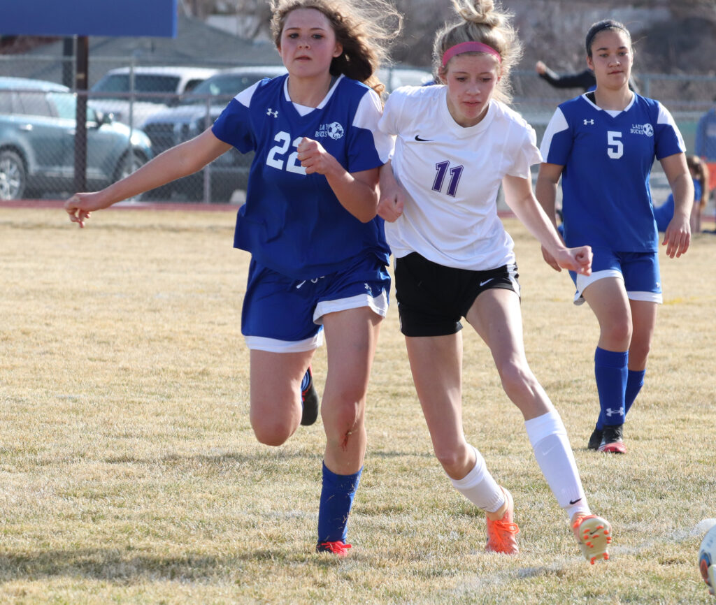 Ella Peterson tries to outrace a Spring Creek player to the ball. /Ron Espinola • The Brand