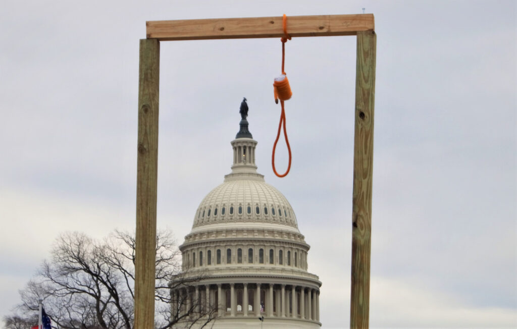 A gallows hangs near the United States Capitol during the 2021 storming of the United States Capitol on January 6, 2021. /Courtesy • Tyler Merbler from wikimedia