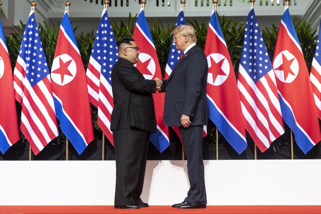 Kim and Trump shaking hands at the red carpet during the DPRK–USA Singapore Summit./Courtesy • Dan Scavino via wikimedia