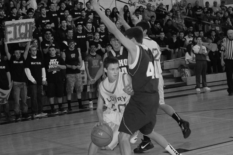 Sterling Dennis tries to dribble around an Elko defender. /Taylor LaTray • The Brand