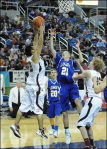 Lowry's Brandon Eastman tries to block an Elko player's shot. /Courtesy