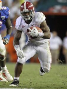 Alabama running back Trent Richardson runs for a first down during the second quarter against Florida. /Gary W. Green • Orlando Sentinel/MCT