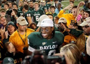 Baylor Bears quarterback Robert Griffin III (10) is all smiles during an interview after the game against the University of Texas. /Vernon Bryant • Dallas Morning News/MCT