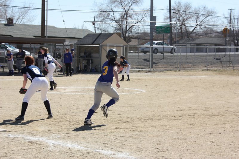 Lexie Coleman takes her lead from first base. /Courtesy • Winnada
