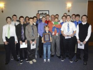 The varsity basketball, team, friends, and family joined Vince Mendiola at his induction. /Courtesy • Dana Peters