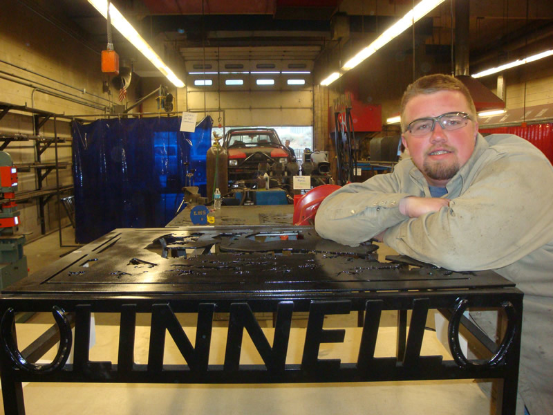 Mark Linnell shows off his welding project. /Harley Long • The Brand