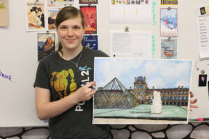 Mellen displaying one of her pieces of artwork. /Madison Waldie • The Brand