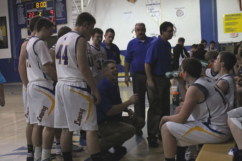 Coach Peters addresses the team during a timeout. /Ron Espinola • The Brand