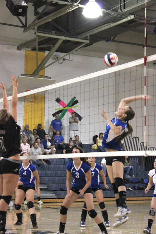 Paige Theide goes up for the hit. /Courtesy • Winnada