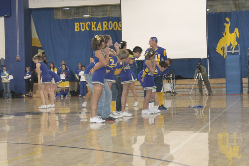 Cheerleaders routine included the football players at the Friday pep assembly. /Harley Long • The Brand