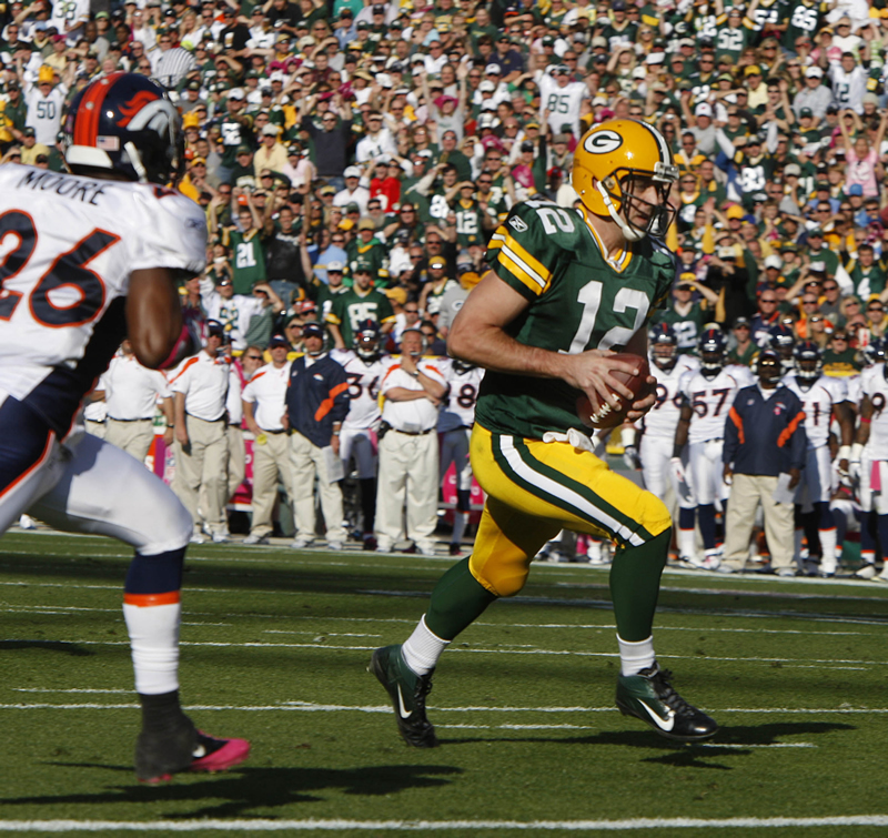 Green Bay Packers Aaron Rogers runs for a touchdown against the Denver Broncos at Lambeau Field. /Rick Wood • Milwaukee Journal Sentinel/MCT