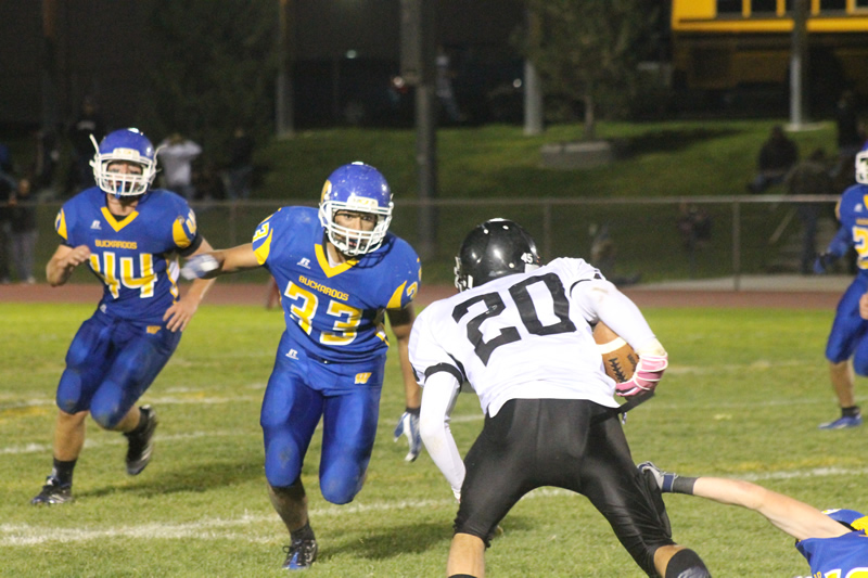 Bryan Noble (44) and Michal Arenas (33) set their sites on the Spartan runningback. /Cole Erquiaga • The Brand