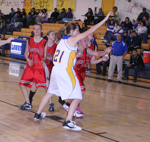 Lowry players fight for position against Wooster . /Courtesy • Winnada