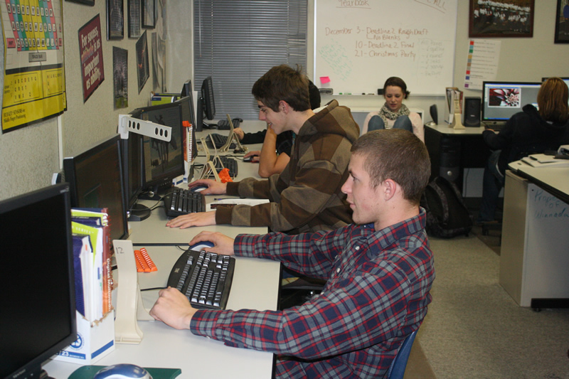 Chris Kitras and Dakota Flanagan are typing away on the modern computer in Mrs. Lisa Scott's 6th period class./Calvin Connors • The Brand