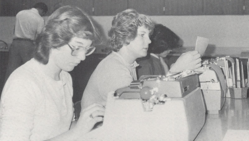 Back in the day (1980) these two hard working young women are typing away on old-fashioned, manual typewriters. /Courtesy • Winnada (1980)
