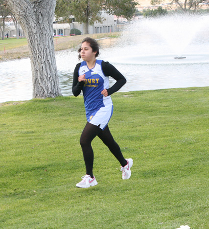 A Lowry cross country runner participates in the home invitational. /Ron Espinola • The Brand