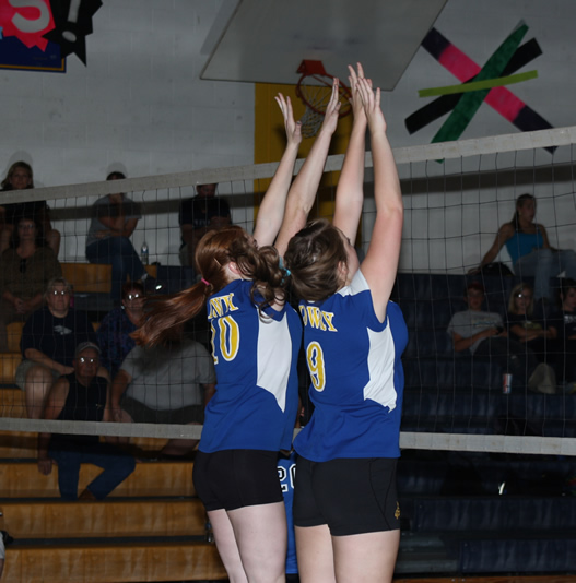 JV volleyball players try to block. /Brandon Eastman • The Brand