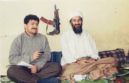 Hamid Mir interviewing Osama bin Laden for Daily Pakistan in 1997. Behind them on the wall is an AKS-74U carbine.  /Courtesy • Hamid Mir