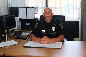 Officer Whittaker in his office./Araceli Galarza • Lowry Multimedia Communications