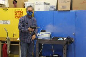 Gerardo Zuniga with equipment used for deep cleaning the school./Araceli Galarza • Lowry Multimedia Communication
