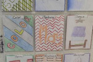 An example (center) of Robert Rangel's artwork on display in the Art Building./Bree Dunckhorst • Lowry Digital Media