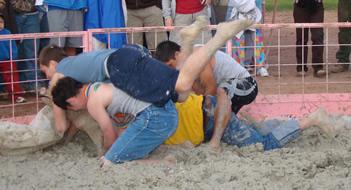 Pig wrestling: 'Clean, dirty, fun.'