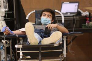 Robert Rangel relaxing while he donates blood on February 18, 2021. /Chris Gildone • The Brand