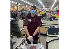 Austin Lloyd posing at the cash register at Khoury's./Octavio Ruiz • The Brand