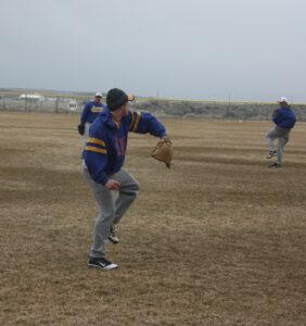 Cody Green (L) works on throwing mechanics early in the season. /Courtesy • Winnada