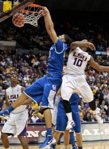 Kentucky Wildcats forward Anthony Davis (23) dunks on LSU Tigers guard Andre Stringer (10). Kentucky defeated LSU 74-50. /Mark Cornelison • Lexington Herald-Leader/MCT
