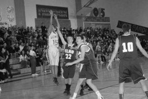 Chris Mendoza shoots over two Elko defenders. /Taylor LaTray • The Brand