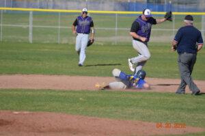 Johnny Hernandez slides into second base against Spring Creek. /Courtesy • Lorin Noble