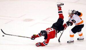 The Philadelphia Flyers' Danny Briere (48) trips New Jersey Devils' Dainius Zubrus. /Yong Kim • Philadelphia Daily News/MCT