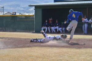 Brandon Okuma jumps over the Damonte Ranch catcher to score a run. /Courtesy • Lorin Noble